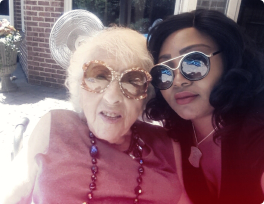 Nurse and her senior patient wearing shades
